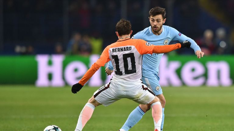 Manchester City's Portuguese midfielder Bernardo Silva (R) passes the ball during the UEFA Champions League group F football match between Shakhtar Donetsk