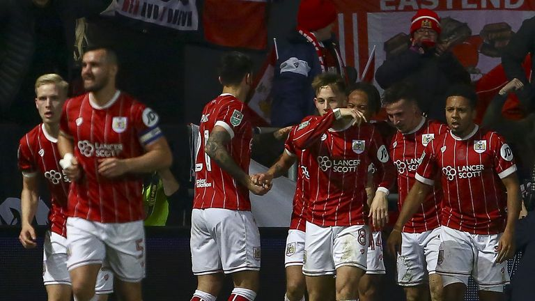 Bristol City's defender Joe Bryan celebrates with teammates, scoring the team's first goal during the English League Cup quarter-final football match
