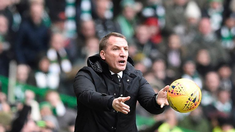 Brendan Rodgers retrieves the ball during the Scottish Premiership match with Rangers