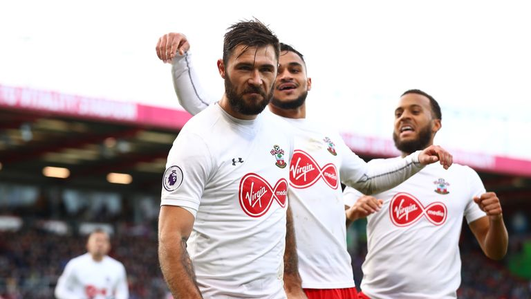 BOURNEMOUTH, ENGLAND - DECEMBER 03: Charlie Austin of Southampton celebrates after scoring his sides first goal with Sofiane Boufal of Southampton and Ryan