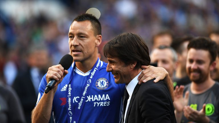 LONDON, ENGLAND - MAY 21:  John Terry of Chelsea and Antonio Conte, Manager of Chelsea celebrate after the Premier League match between Chelsea and Sunderl