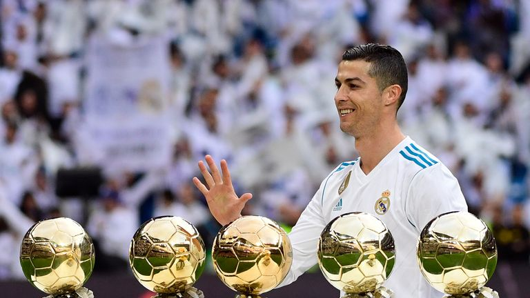 Real Madrid's Portuguese forward Cristiano Ronaldo poses with his five Ballon d'Or trophies ahead of the Spanish league football match between Real Madrid