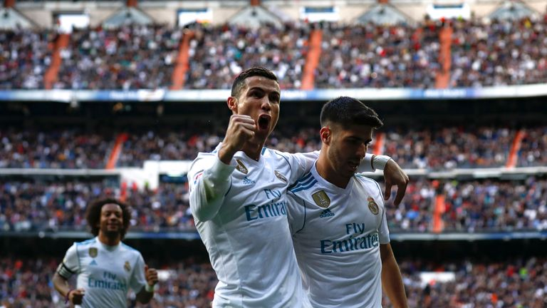 Cristiano Ronaldo celebrates scoring Real Madrid's second goal Marco Asensio