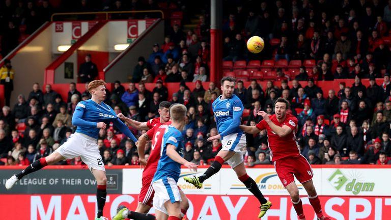 Wilson (second right) scores Rangers' first goal against Aberdeen
