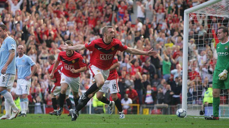 Darren Fletcher celebrates scoring their third goal during the Premier League match between Manchester United and Manchester City at Old Trafford