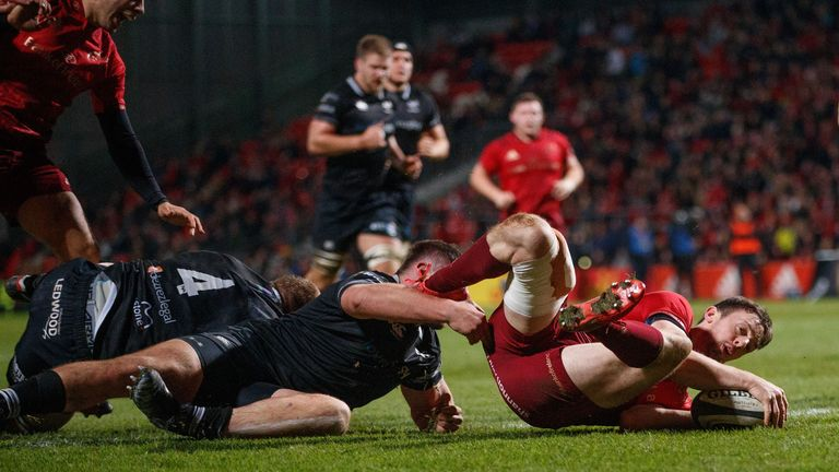 Munster's Darren Sweetnam goes over for his sides second try
