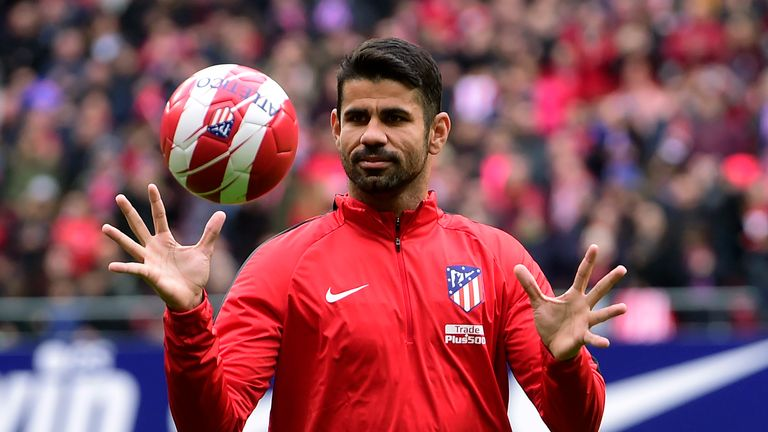 Atletico Madrid's Spanish forward Diego Costa catches a ball at the start of a training session following his welcoming ceremony at the Wanda Metropolitan