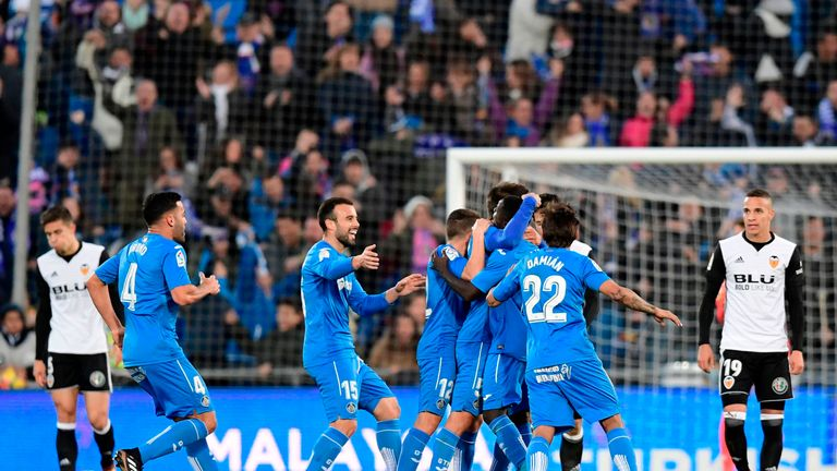 Getafe's players celebrate after scoring a goal during the Spanish league football match Getafe CF vs Valencia CF at the Col. Alfonso Perez stadium in Geta