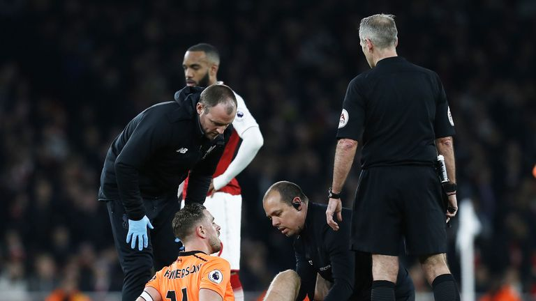 Jordan Henderson receives treatment on the pitch during the Premier League match between Arsenal and Liverpool