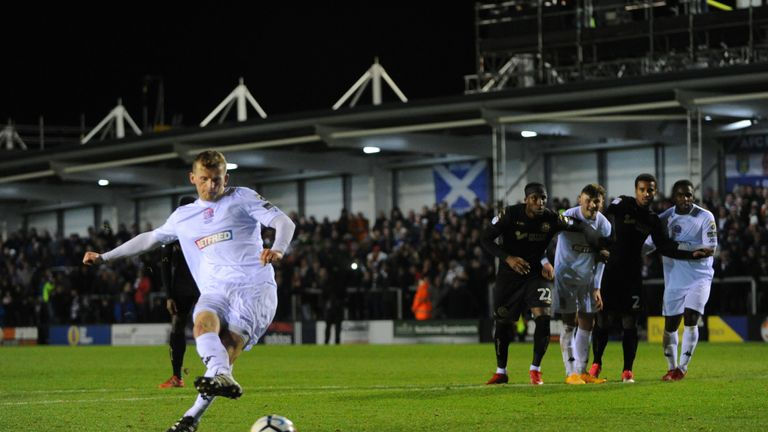 Danny Rowe's penalty earned AFC Fylde a second shot at Wigan Athletic