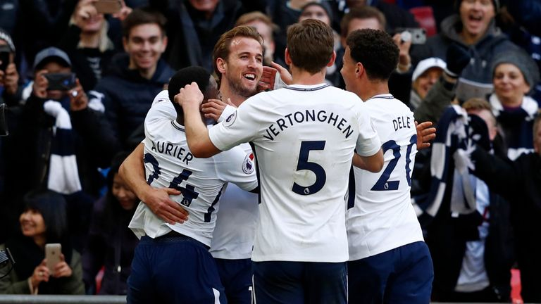 Harry Kane celebrates with team-mates after he scores the opening goal of the game