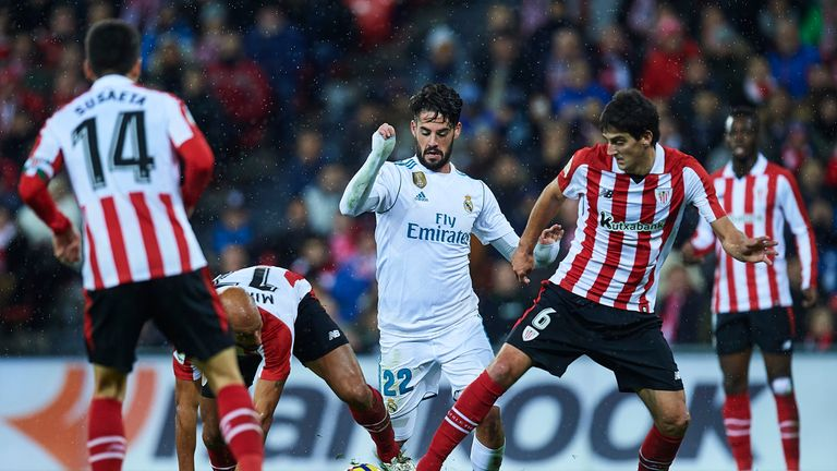 BILBAO, SPAIN - DECEMBER 02:  Isco Alarcon of Real Madrid CF (C) being followed by Mikel Rico of Athletic Club (L) and Mikel San Jose of Athletic Club (R)