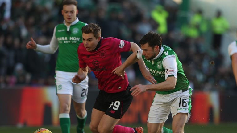 Hibernian's Lewis Stevenson battles the ball with Celtic's James Forrest (left)