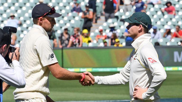 Steve Smith (R) shakes hands with England captain Joe Root