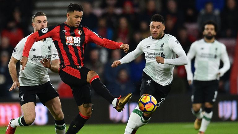 Joshua King (C) vies with Alex Oxlade-Chamberlain in December's meeting - which ended 4-0 to Liverpool