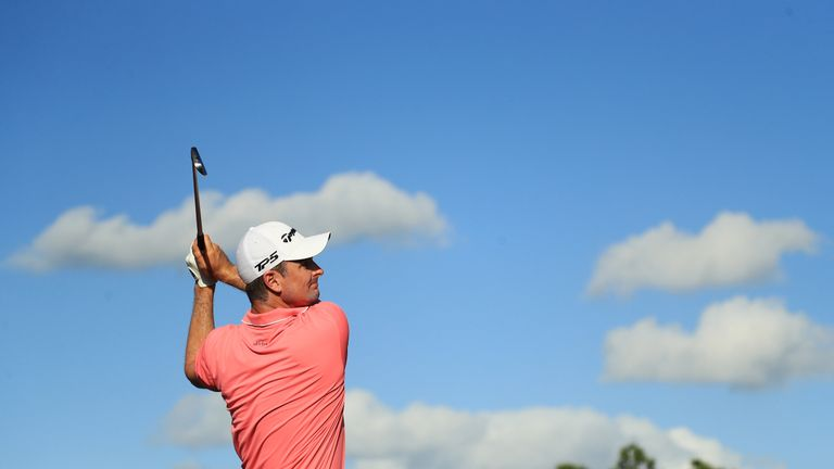 Justin Rose failed to build on a bright start but retained a share of second