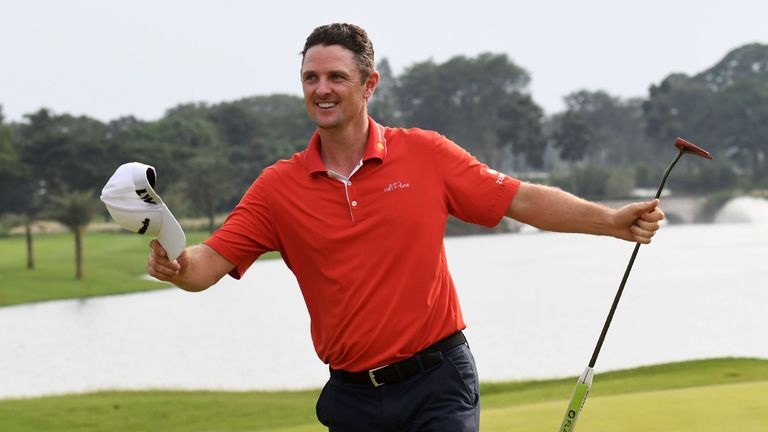 Justin Rose celebrates after making his final putt to win the Indonesian Masters