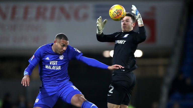 Cardiff City's Kenneth Zohore (left) and Preston North End goalkeeper Chris Maxwell battle for the ball