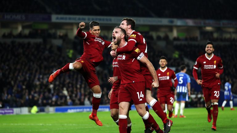 Jordan Henderson of Liverpool celebrates after Philippe Coutinho scores against Brighton
