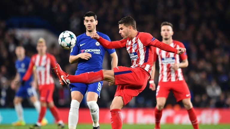 Lucas Hernandez and Alvaro Morata battle for the ball