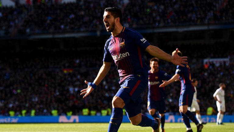 MADRID, SPAIN - DECEMBER 23: Luis Suarez of Barcelona celebrates after scoring his sides first goal during the La Liga match between Real Madrid and Barcel