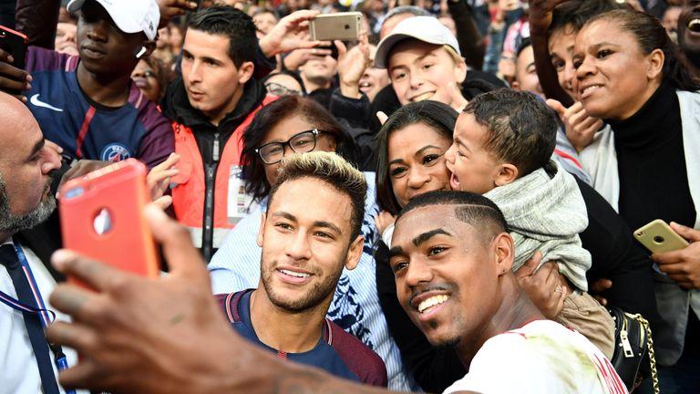 Neymar, left, and Malcom indulge in a selfie