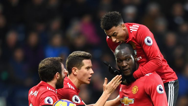 WEST BROMWICH, ENGLAND - DECEMBER 17:  Romelu Lukaku of Manchester United celebrates after scoring his sides first goal with teammates Juan Mata, Ander Her