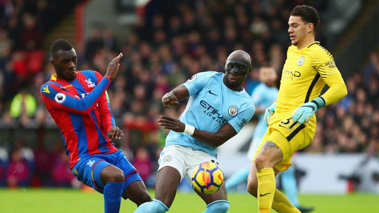 Christian Benteke is foiled by Eliaquim Mangala and Ederson during the Premier League match