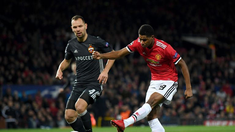 MANCHESTER, ENGLAND - DECEMBER 05:  Marcus Rashford of Manchester United shoots during the UEFA Champions League group A match between Manchester United an