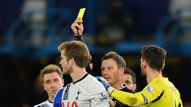 Eric Dier is shown a yellow card by Clattenburg on the ill-fated night 18 months ago