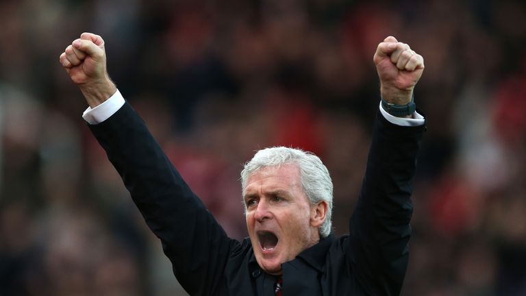 Mark Hughes celebrates Stoke's first goal in the 3-1 win over West Brom