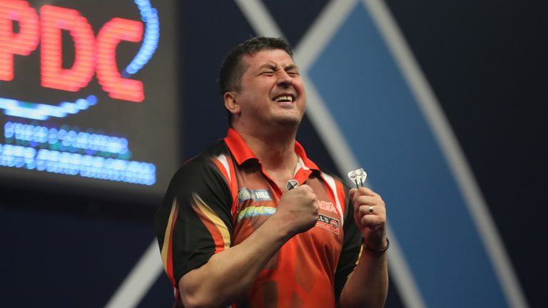 Mensur Suljovic reached the last 16 of the World Championship after a gruelling victory over Robert Thornton