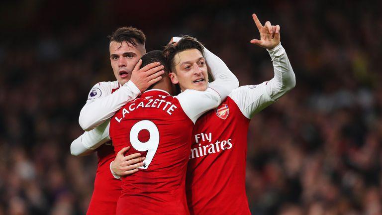 Mesut Ozil celebrates Arsenal's third goal with Granit Xhaka and Alexandre Lacazette
