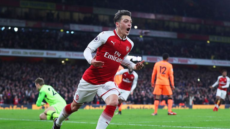 Mesut Ozil celebrates after giving Arsenal a 3-2 lead at home to Liverpool