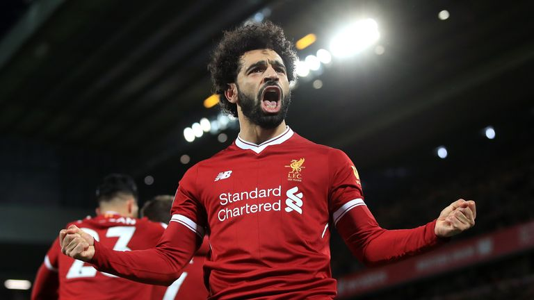 Salah celebrates scoring his second goal