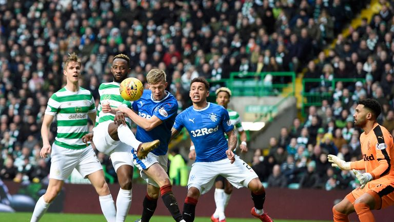 Moussa Dembele attemps a shot on goal under pressure from Ross McCrorie