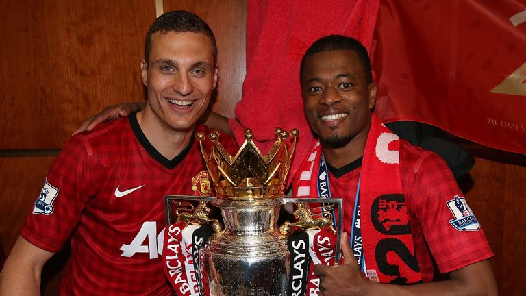 Nemanja Matic and Patrice Evra at Old Trafford on May 12, 2013 in Manchester, England.