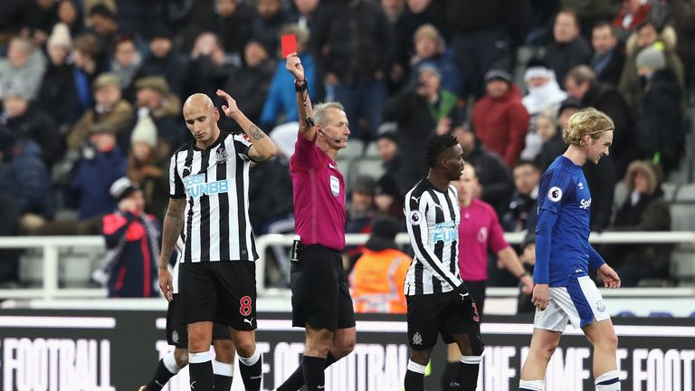 NEWCASTLE UPON TYNE, ENGLAND - DECEMBER 13: Jonjo Shelvey of Newcastle United is shown a red card by referee by Martin Atkinson during the Premier League m