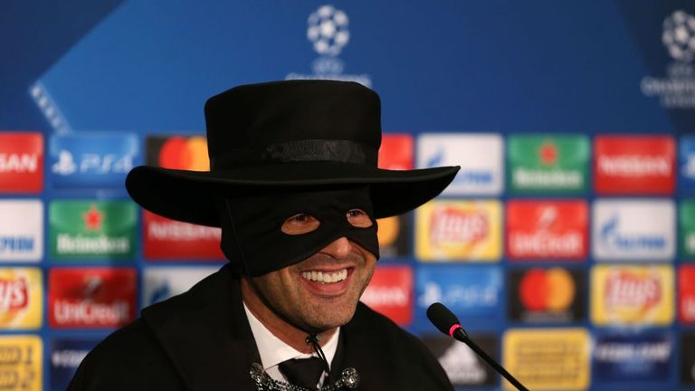 Shakhtar Donetsk's Portuguese manager Paulo Fonseca dons a Zorro mask, cape and hat