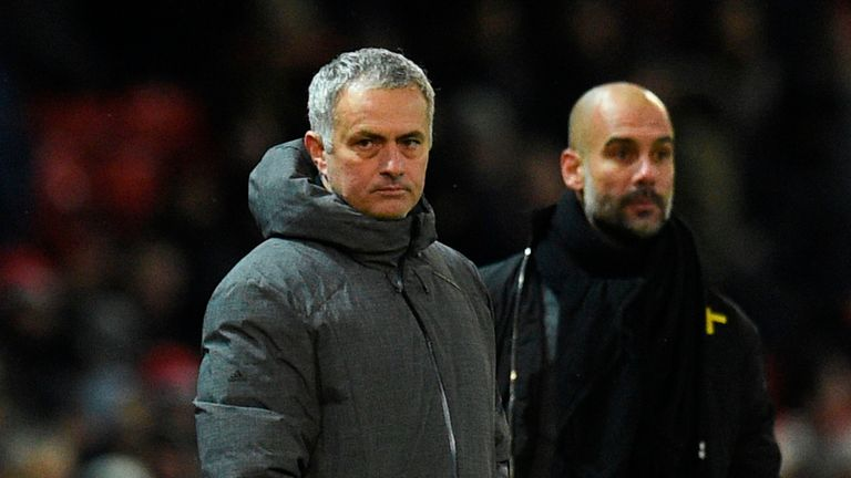 Manchester United's Portuguese manager Jose Mourinho (L) and Manchester City's Spanish manager Pep Guardiola (R) watch from the touchline during the Englis