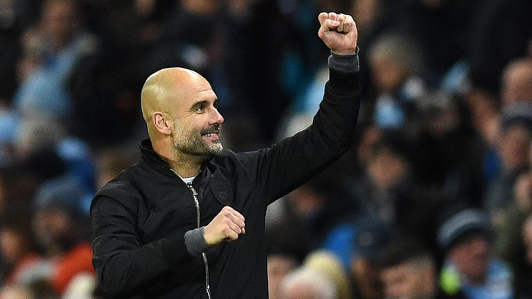 Manchester City's Spanish manager Pep Guardiola celebrates their win on the final whistle in the English Premier League football match between Manchester C