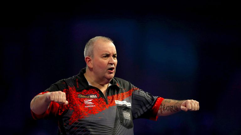 Phil Taylor reacts during his semi-final victory over Jamie Lewis in the World Championship