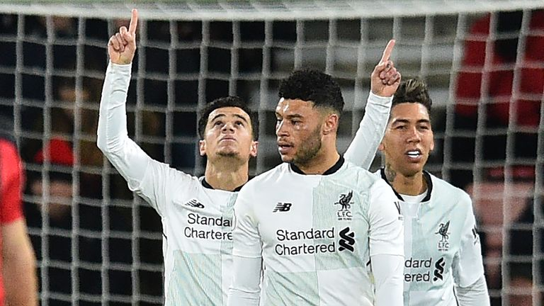 Liverpool's Brazilian midfielder Philippe Coutinho (L) celebrates after scoring the opening goal of the English Premier League football match between Bourn