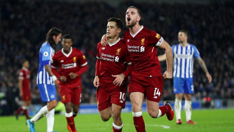 BRIGHTON, ENGLAND - DECEMBER 02:  Philippe Coutinho of Liverpool celebrates with team-mates including Jordan Henderson after scoring his team's fourth goal