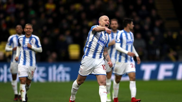 Aaron Mooy celebrates after making it 2-0 to Huddersfield