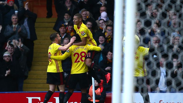 Andre Carrilo of Watford celebrates with team-mates after scoring his side's first goal