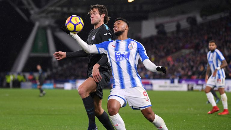Elias Kachunga handles the ball under pressure from Marcos Alonso