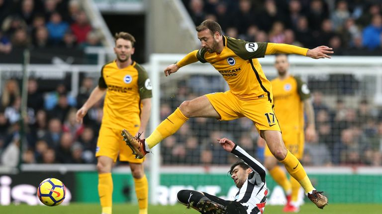 Glenn Murray evades the challenge of Mikel Merino