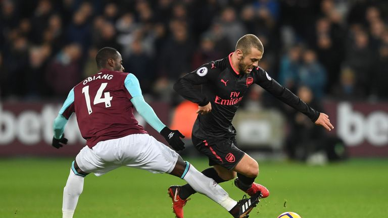 Jack Wilshere gets away from Pedro Obiang