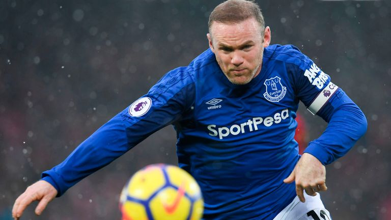 Wayne Rooney in acton during the Merseyside derby at Anfield